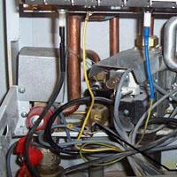 Jak oczyścić przetwornik przepływu wody w piecu Minimax Plus